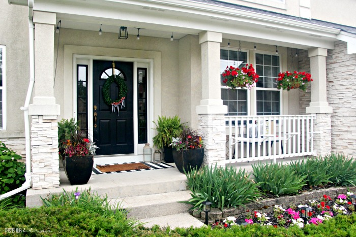 Small-Front-Porch-decorating-ideas-with-hanging-baskets-and-lights-This-is-our-Bliss